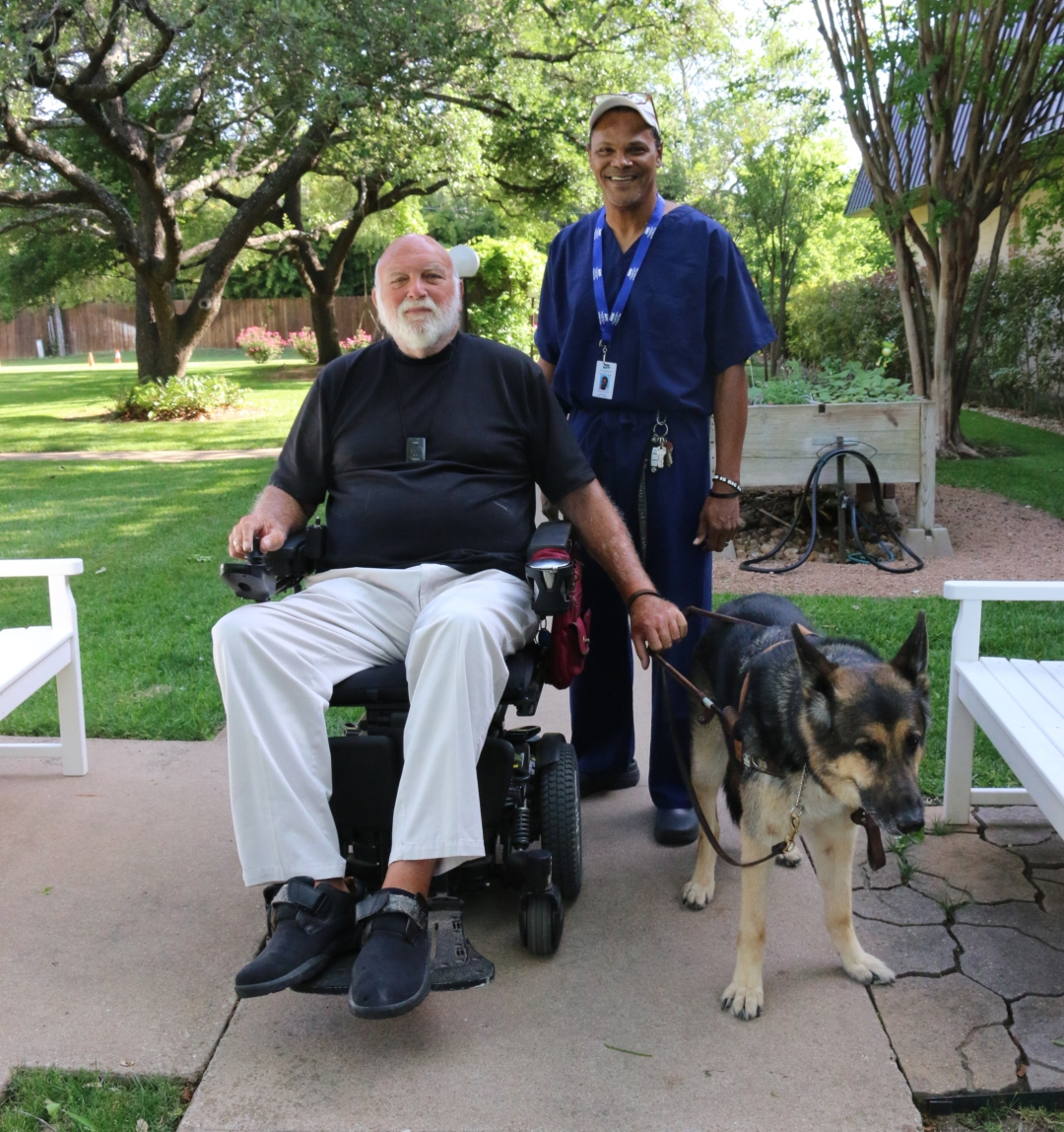 An In-Home Care Recipient Pictured with Support Dog and Care Giver